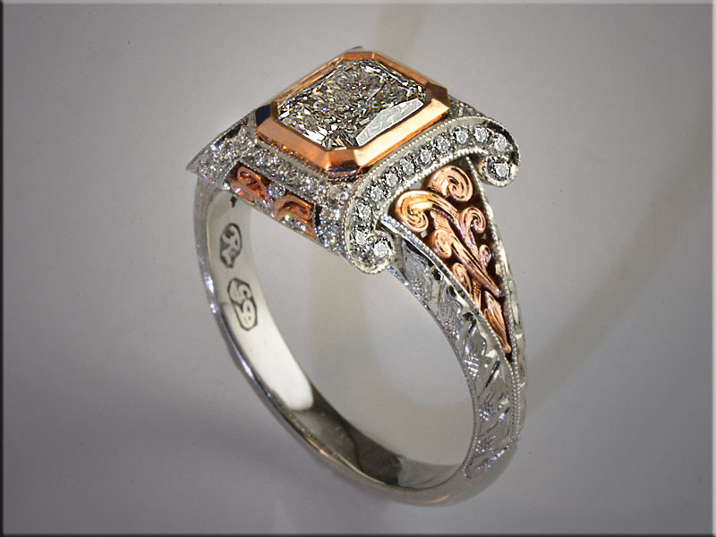 p507<br /> 14K White and Rose Gold Custom Remont for Customer's Radiant Cut Center Diamond, with 3-D style Scroll and Hand Engraved Sides.  Design by RonLitolff