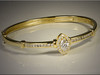 14K yellow gold bracelet using customers diamonds from an unused wedding set.  Designed and made by Ron Litolff.