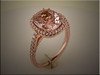 14K custom rose gold mounting for Morganite.  Ideal cut diamonds in shoulders and in halos.  Designed and made by Ron Litolff
