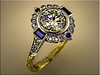 Exquisite custom two tone ring with diamonds and sapphires designed and engraved by Tim Frank