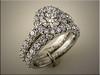Custom platinum wedding set with multiple diamonds set shared prong style.   By Ron Litolff