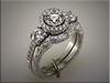 Custom platinum wedding set using customers diamonds made and hand engraved by Ron Litolff