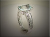 14K white gold partial bezel mounting for  cushion shape aquamarine.  Designed made and engraved by Ron Litolff