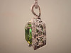 Beautiful 14K white gold diamond mounting for mint tourmaline designed and made by Tim Frank