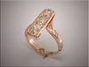 Unique rose gold ribbon style ring to remount customers mine cut diamonds.  Design by Tim Frank, made set and engraved by Ron Litolff