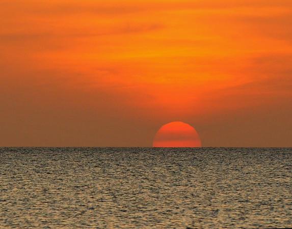 Sun going down on ocean
