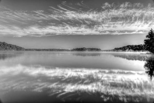 Sunrise and great clouds on lake B&W