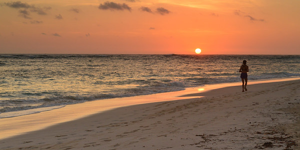 Sunrise in Punta Cana and jogger