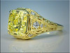 18K Yellow Gold Custom Open Scroll Mounting for 5.45ct Internally Flawless Fancy Yellow Radiant Cut Diamond.  Designed and made by Ron Litolff.
