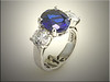 14K white gold custom band for oval sapphire and round diamonds.  Designed and made by Tim Frank