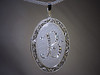 p489<br /> Custom locket made for Extreme Makeover with Ty Pennington.  Hand engraved border with Diamond initial in center.
