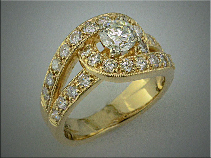 14K yellow gold remount of customers diamonds in bypass, swirling design.  Based on customers input, made by Ron Litolff
