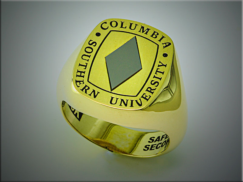 18K yellow gold, custom college ring with diamond shaped piece of tungsten carbide.  Made by Ron Litolff
