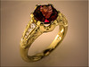 Custom 18K yellow gold ring for customers hexagon custom cut garnet designed by Ron Litolff and engraved by Tim Frank
