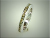 Unique 14K white gold band with rough diamonds set channel style, by Ron Litolff