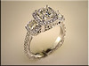 14K white gold 3 stone mounting with halos on 3 sections designed and made by Tim Frank
