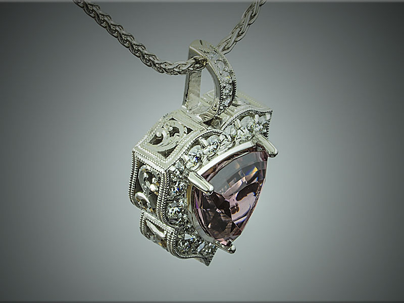 Exquisite, 14K white gold purple spinel and diamond pendant with hand engraved scroll patterns on sides and back.  Designed, engraved and made by Tim Frank