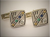 14K white gold cuff links with diamonds and birthstones of family members by Ron Litolff