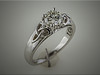 14K white gold engagement ring with raised Trinity knot on each side.  Designed and mady by Ron Litolff.