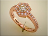 14K rose gold engagement ring in hexagonal center section.  Designed and made by Ron Litolff