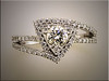 14K white gold custom diamond with round center diamond in triangular center. Set with ideal cut diamonds.  Designed and made by Ron Litolff
