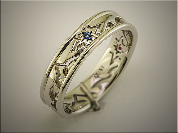 Another customer design comes to life with this patterened open band with colored stones, by Tim Frank