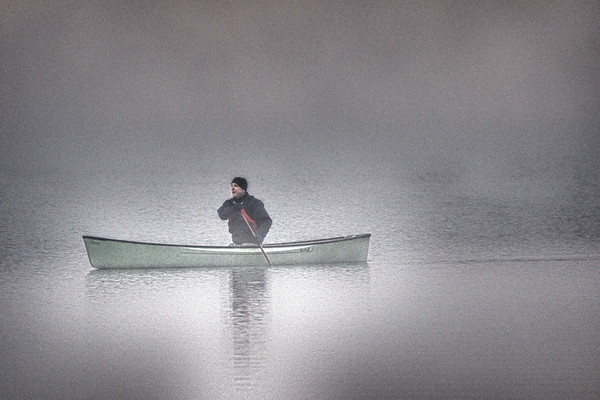 Canoeing in the early morning fog