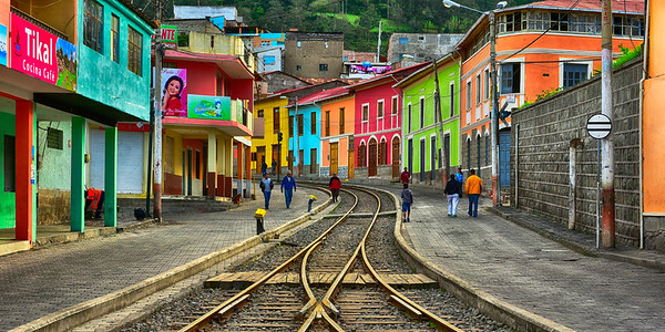 Train tracks and colorful buildings