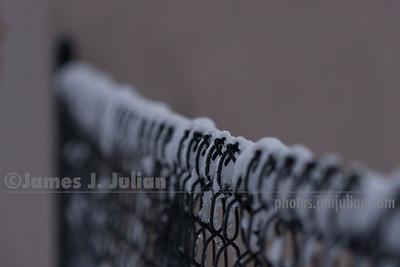 Snow Across a Fence