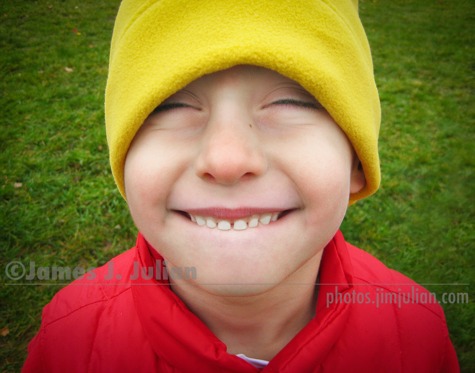 Smiling Boy with Eyes Closed