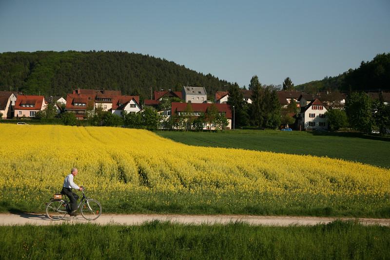 man, bike and field