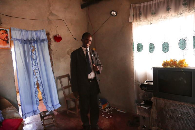 Rev. Lazarus Chilenje, in his home