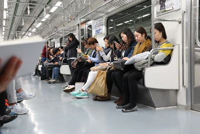 Every single person on subway holds a smartphone or some type of handheld gadget in Korea. No exceptions!