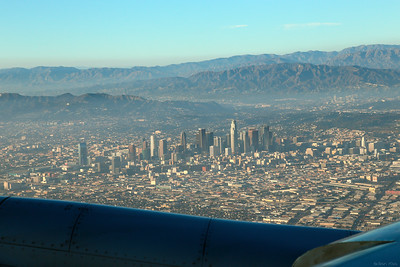 Looking at Downtown Los Angeles to the right, Santa Monica mountain in the middle where you can see the Hollywood sign and Griffith observatory from an airplane preparing to land on LAX