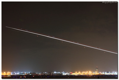 Light trails from an airplane taking off at LAX