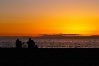 A couple watching a sunset, Venice beach