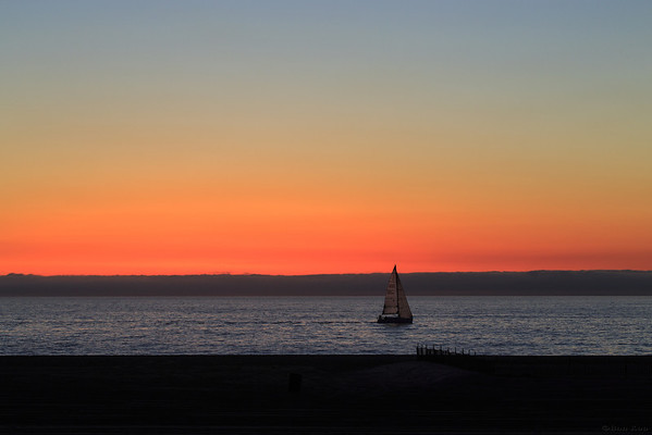 Yacht  sailing at Venice beach during twilight