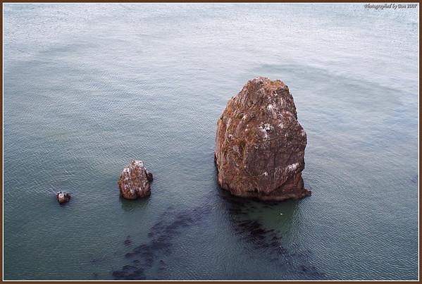 Three rocks interestingly lined up next to Golen Gate bridge