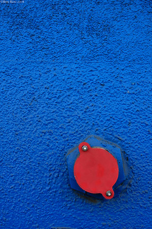 Fire hydrant on a blue wall
