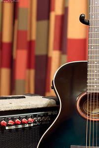 a guitar against an amp