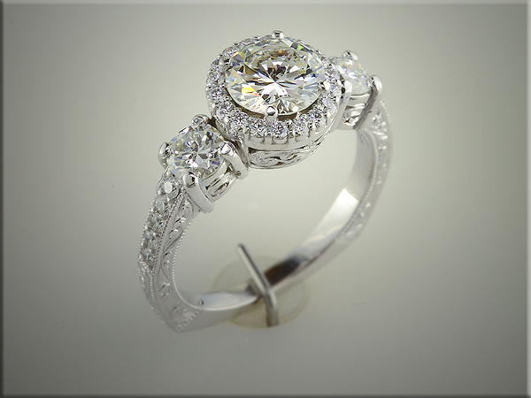 Platinum custom mounting with diamond halo and diamond shoulders, designed, made and hand engraved by Ron Litolff