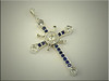 14K white gold custom cross with rounds and baguette diamonds and sapphires, designed and made by Tim Frank