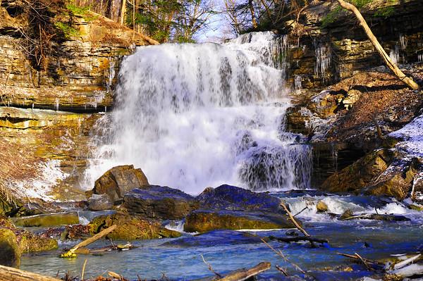 Falls below