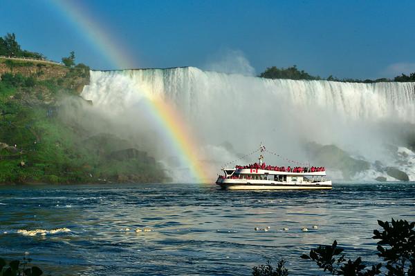 Rainbow and boat in Niagara River at American Falls