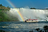 Rainbow and boat in Niagara River at American Falls