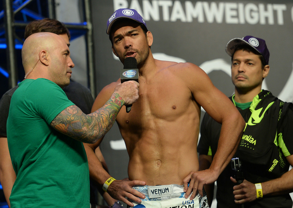 . Lyoto Machida talks with UFC commentator Joe Rogan during weigh-ins for UFC 175 at the Mandalay Bay Events Center July 4, 2014. (Photo by Hans Gutknecht/Los Angeles Daily News)