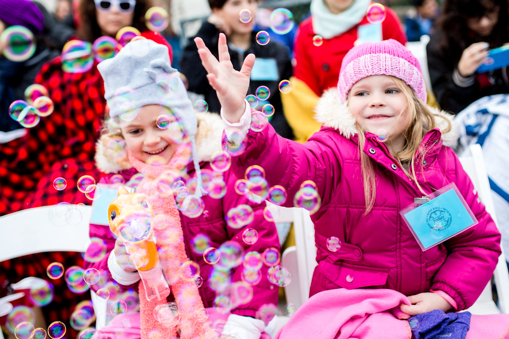 . Ashton Dilley, right, with cousin Evangeline Scolinos, both 6, play with bubbles as they wait to watch their sixth Rose Parade on Colorado Blvd. during the 2017 Rose Parade in Pasadena on Monday, January 2, 2017. (Photo by Watchara Phomicinda, San Gabriel Valley Tribune/ SCNG)
