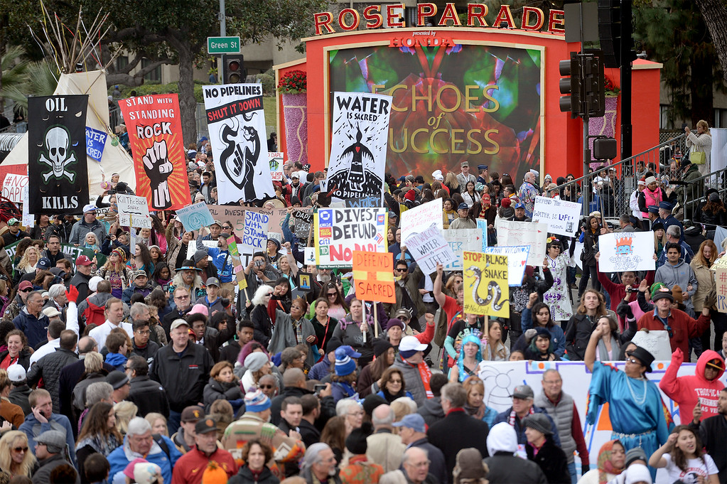 . Anti-Dakota Pipeline activists march in protest following the end of the Rose Parade in Pasadena, Calif. on Monday, Jan. 2, 2017.  (Photo by Leo Jarzomb, SGV Tribune/ SCNG)