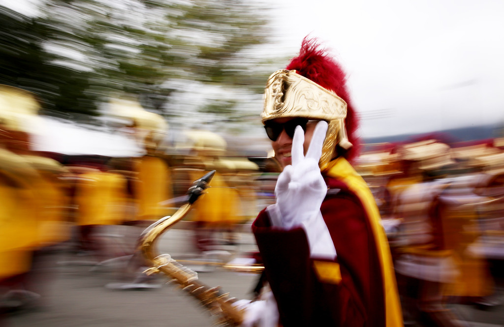 """. A member of USC\'s marching band gives the \""""Fight On\"""" sign after completing  the 128th Rose Parade in Pasadena, Calif. on Monday, Jan. 2, 2017. (Photo by Trevor Stamp)"""