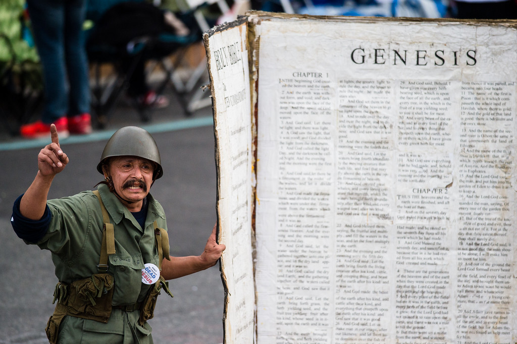 . A religious activists strolls a life-size Bible along Colorado Blvd. before the 2017 Rose Parade in Pasadena on Monday, January 2, 2017. (Photo by Watchara Phomicinda, San Gabriel Valley Tribune/ SCNG)